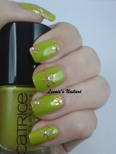 #31dc2 Day 2 Green or Yellow. This is a fugly color by itself, but combined with the gold nailfoil and gems, i like it!  Catrice ACid/DC Leonie's Nailart