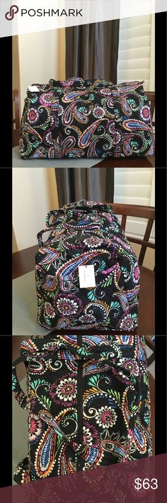 "NWT VERA BRADLEY LARGE DUFFEL Brand new with tags Vera Bradley large duffel  Bandana swirl pattern  15"" strap drop Handy outside end pocket Folds flat for easy storing Dimensions 22"" W x 11½"" H x 11½"" D - 15"" strap drop Duffle Smoke/pet free home Vera Bradley Bags Travel Bags"