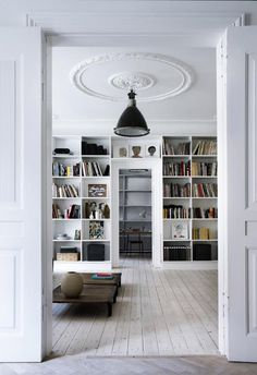 large ceiling Rose is a real feature for this all white room. Love this blog on Ccandinavian interiors and arcitecture | Scandinavian Retreat #ceilingrose