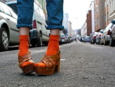 Make a statement with clogs and eye-catching orange socks