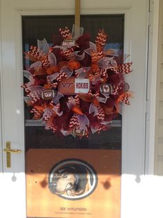 My latest order..VA TECH wreath.  Smokey is angry with me as you can see but not to worry as my blood is still UT orange..GBO!