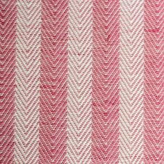 Rustic Ticking Stripe Fabric An upholstery fabric with a herringbone stripe woven in red and white.