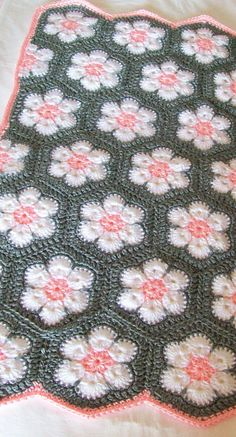 Handmade African Flower/Hexagon Baby Blanket.  Color: Gray, Pink, & White.  Measures 30 x 26 and is made from 100% soft acrylic yarn. Machine washable and dryable on low settings.  Brand new and Ready to Ship!  Hand crocheted by me and comes from a non-smoking home.  Great size for a Crib, Stroller, or Car Seat Blanket. Custom orders are also welcome if you would like this in a different color or size.  Please contact me if you have any questions and check out my store for more handm...