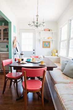 Could this work for the back room at Carnegie house? It's a long room but not very wide, banquette could go along the back wall, with two sitting chairs and a table between at the back...?