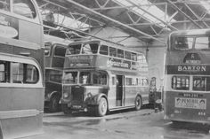 Barton - Vintage monochrome images. Assorted deckers inside Chilwell garage
