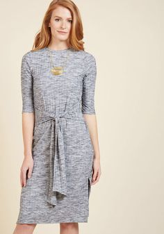 131052A All dressed up in this heather grey dress and nowhere to go? Consult your to-visit list and then point the front tie of this 3/4-sleeved stunner in that direction! Made from a wide-ribbed knit and falling to a midi length, this versatile frock looks fab i