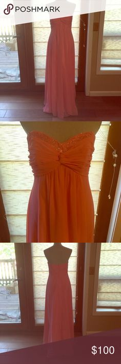 David's Bridal bridesmaid/prom dress This is a beautiful, long, coral colored David's Bridal dress that I wore only one time as a bridesmaid. It was originally $150 or $200. You could easily hem this dress and make a super cute short dress as well. Please comment if you have any questions!! David's Bridal Dresses Prom