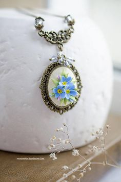 Forget me nots floral pendant Tiny blue flowers on bronze solid base Miniature myosotis flowers as romantic gift for your beloved person Made of polymer clay and not fragile Size: 3x4 cm (1 1/8 x 1 9/16 inch)