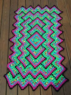 "Chelsea Rimer: ""I have to THANK YOU for the wonderful yarn colors this year! I made this using Blacklight, SHocking Pink, Turqua, and Glowworm People are having a hard time believing it's all super saver!""  Pattern is here/ http://www.ravelry.com/patterns/library/drop-in-the-pond-lap-blanket"