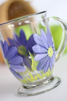 https://flic.kr/p/9BFBx7 | Purple daisy coffee or tea hand painted mugs | Hand painted wine glasses, martini, kitchen and more.  Top rack dishwasher safe and comes with a care tag so people know this.  Personalization is FREE of charge.  Wholesale pricing for private orders available.