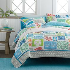 This quilt is a celebration of all things beachy with its whimsical icons of the sea, from ocean waves and coral formations to shells, sand dollars and fish. The Company Store Beds For Sale, Bedding Sets, Summer Beach House, Bed, House, Coastal Bedrooms, Beach Bedding, Beach Bedspreads, Bedroom Colors