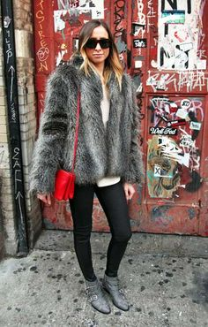 Skinny jeans, studded boots, and fur combine for rock-glam in NYC #streetstyle