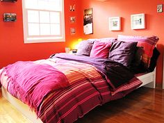 purple sheets | Tangerine bedroom with purple bedding
