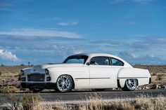 """Custom car builder Ringbrothers has done it again for SEMA. This creation is an interesting fusion of old and new: a 1948 Cadillac fastback with an ATS-V engine and technology.To create the """"Madam V,"""" Ringbrothers started with a chassis of the 2016 Cadillac ATS-V and lengthened it by 14 inches to accommodate the longer body..."""