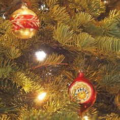 The living room tree is all vintage and family ornaments. These two were from our tree when I was a girl. At the time they were very inexpensive baubles. Now they are valued vintage treasure.