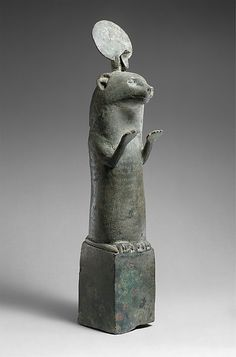 Otter, Late Period or Ptolemaic Period, 664–30 B.C. Bronze or copper alloy - During the Late Period and Ptolemaic times otters were represented in bronzes statuettes such as this one, standing, forepaws raised, atop small bronze boxes. The pose of raised paws signifies the otter's adoration of the sun god when he rises in the morning. In myth otters were attached to the goddess of Lower Egypt Wadjet, whose cult was centered in Buto, in the northern Delta.