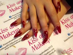 My client wanted red stilettos for Christmas and I am to please. She chose s dark red from my bluesky collection and topped her ring finger nail with a sparkly number in the same brand.