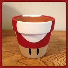 Super Mario Mushroom Planting Pot Super Mario Birthday, Mario Birthday Party, Super Mario Party, Super Mario Bros, Mario Crafts, Nintendo Party, Flower Pot Crafts, Flower Pots, Clay Pot Projects