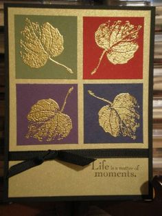 gold embossed leaves on four rich color squares...mat gold background...black card and simple knotted ribbon...elegantly beautiful!!