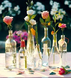 Recycle old wine bottles and use them as a centerpiece for your wedding breakfast. Simple and elegant Wine Bottle Centerpieces, Flower Centerpieces, Wedding Centerpieces, Wedding Table, Diy Wedding, Wedding Flowers, Dream Wedding, Wedding Decorations, Bottle Candles