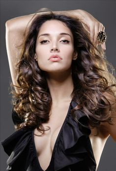 Amelia Vega (born November 7, 1984 in Santiago de los Caballeros, Dominican Republic). She became the first Dominican woman to be named Miss Universe, in 2003.