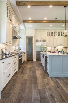 Soft blue and white kitchen with hardwood floors! - Soft blue and white kitchen with hardwood floors! Best Flooring For Kitchen, Hardwood Floors In Kitchen, Hardwood Floor Colors, Home Renovation, Home Remodeling, Kitchen Remodeling, Planchers En Chevrons, Blue Kitchen Cabinets, Kitchen Counters