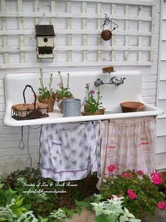 Wonderful use of old sink with washboard for potting bench from Our Fairfield Home & Garden.