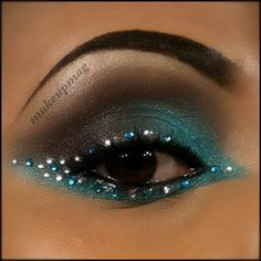 Pretty plum and teal eye shadow with alternating clear and aqua crystals.