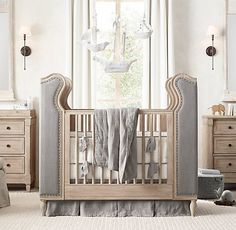 RH baby&child's French Upholstered Wing Crib:The signature silhouette of a…