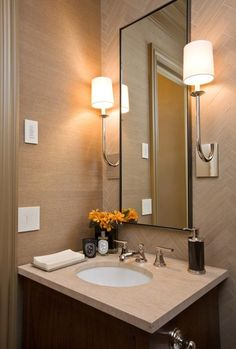 Wall sconces will be off center from the sink but centered for Tall skinny mirror