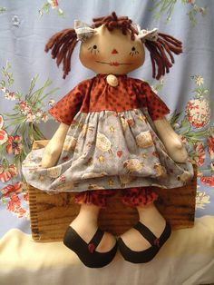 Primitive Cute Raggedy Ann type doll in sheep fabric. $20.00, via Etsy.