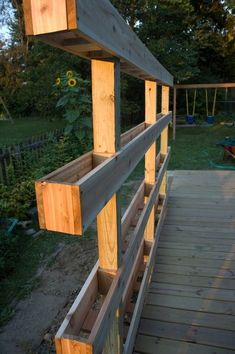 DIY – how to build a verticle garden for your deck @ Pin Your Home or could be used as a privacy screen for an area when plants grow larger?