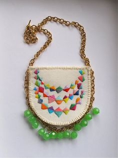 Colorful embroidered necklace with a triple banner triangle design on gold chain with mint green glass beads via Etsy
