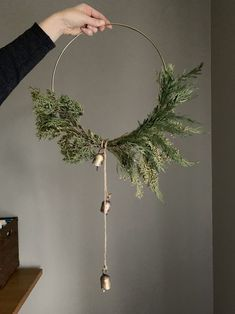 DIY Super simple and modern christmas wreath with hoop and gold bells, click through for item source links christmas decor diy Christmas Decoration Decoration Christmas, Noel Christmas, Christmas Crafts, Scandinavian Christmas Decorations, Natural Christmas Decorations, Natural Christmas Ornaments, Modern Christmas Decor, Christmas Tables, Nordic Christmas