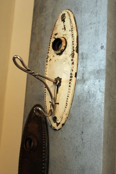 door knob plate and old hanger. I'm going to use several of these for guests handtowel in the 1/2 bath