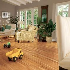 Make your home look polished and classy, even when it is covered in toys with  Addison Hickory laminate floor. :) #LF000659
