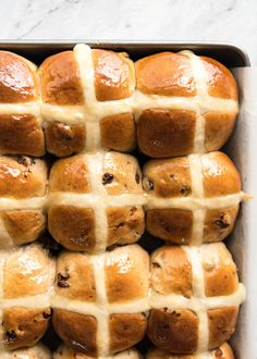 Fluffy, fragrant, homemade Hot Cross Buns recipe. With my quick video recipe and some cheeky but effective tips, these take time but are easy to make!