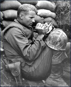 """Accepting her fate as an orphan of war, 'Miss Hap' a two-week old Korean kitten chows down on canned milk, piped to her by medicine dropper with the help of Marine Sergeant Frank Praytor … The Marine adopted the kitten after its mother was killed by a mortar barrage near Bunker Hill. The name, Miss Hap, Sergeant Praytor explained, was given to the kitten 'because she was born at the wrong place at the wrong time'."" Korea, ca 1953"