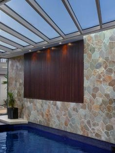 Crazy Paving is used as a feature wall by an indoor pool, love the look, natural stone by DecoR Stone