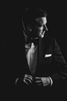 This shot that I grabbed of a groom getting ready went on to win first place in a photo contest. Since winning, I've had a number of people ask me about the lighting for the shot. I thought I would use this opportunity to explain exactly how I shot it.