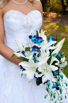 Bouquet of beautiful blue orchids and white lilies.