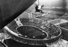 The Hindenburg flying over the 1936 Olympics