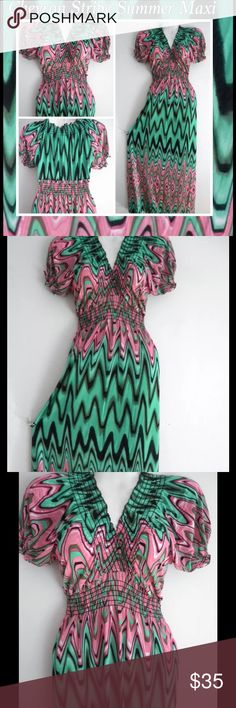 Chevron Striped Summer Boho Maxi This is a beautiful pink and green chevron striped maxi dress. The dress is long in length with a capped sleeve. A size S/M made from polyester. Dresses Maxi