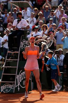 Maria Sharapova - 2014 French Open - Day Fourteen. Maria Sharapova of Russia celebrates match point during her women's singles final match against Simona Halep of Romania on day fourteen of the French Open at Roland Garros on June 7, 2014 in Paris, France.