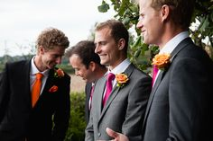 Ali and Lees Colourful Teepee Wedding - Joel wears orange tie and vest with pink boutonniere and the groomsmen do the opposite - pink tie with orange flowers