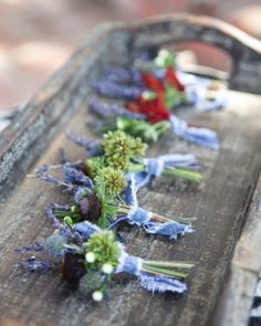 Simple bunches of lavender, kangaroo paw, and Echinacea decorated the guys' lapels... with denim!!!!