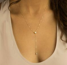 Dainty Y Necklace with a sparkling, subtle CZ accent. A tiny CZ drop hangs from a delicate Y-shaped chain. Delicate, top quality 14k Gold Fill chain, Sterling Silver chain, or 14k Rose Gold Fill chain.   NECKLACE: Delicate Round CZ Y-Necklace - Chain, Wire and findings are top quality USA or Italian made - Sparkling Cubic Zirconia are mounted in gold-plated brass - Comes in a beautiful package - Made to Order, just for you. - Top CZ is 6mm and small CZ at bottom 3mm   …………………………………. LENGTH…