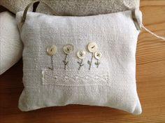 T & Linen, mother of pearl vintage buttons, embrodery and lace make a sweet and special Lavender bag. Lovely buttons