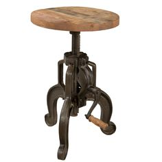 Accent your industrial bar table with this Rigsby adjustable stool. This charming stool boasts a three-leg iron base with a hand crank that controls the seat height. The seat on this stool is wooden, delivering natural appeal to your dining room. Bar Furniture, Furniture Deals, Industrial Furniture, Vintage Industrial, Furniture Outlet, Online Furniture, Counter Bar Stools, Swivel Bar Stools, Dining Room Bar