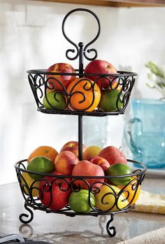 classic scrolled iron tiered fruit stand idea with two storey with holder and three legs Iron Furniture, Steel Furniture, Home Decor Furniture, Fat Chef Kitchen Decor, Apple Kitchen Decor, Tiered Fruit Basket, Wrought Iron Decor, Fruit Stands, Cooking Tools